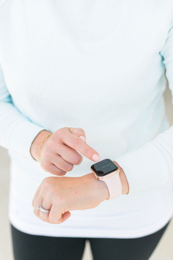 woman using Apple Watch to track healthy habits