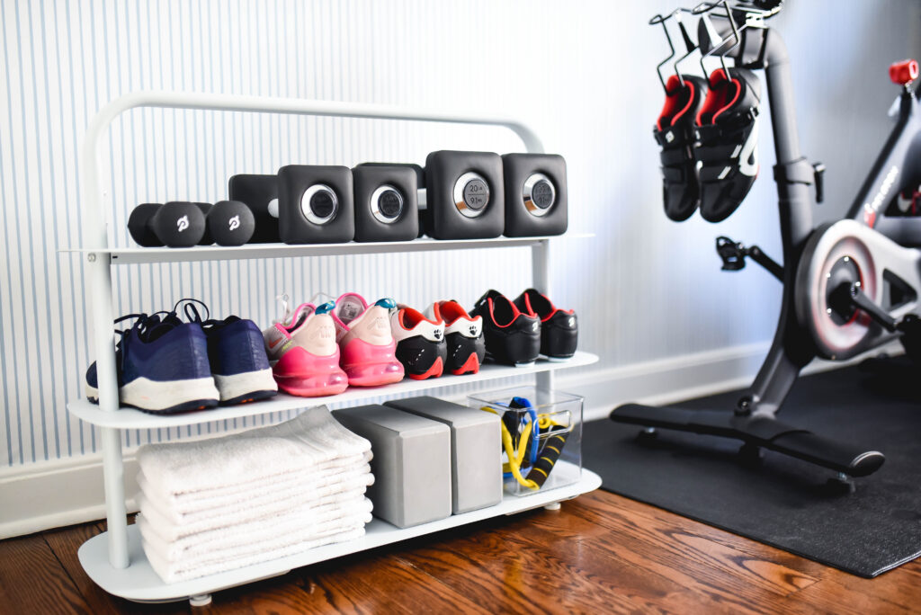 Organized home workout space with Peloton and Open Spaces rack
